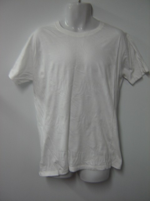 THE LONGEST YARD: Caretaker's ( Chris Rock ) Shirt